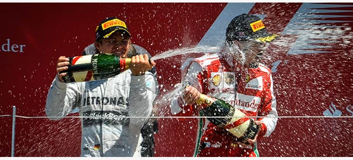 Drivers Celebrating with Champagne